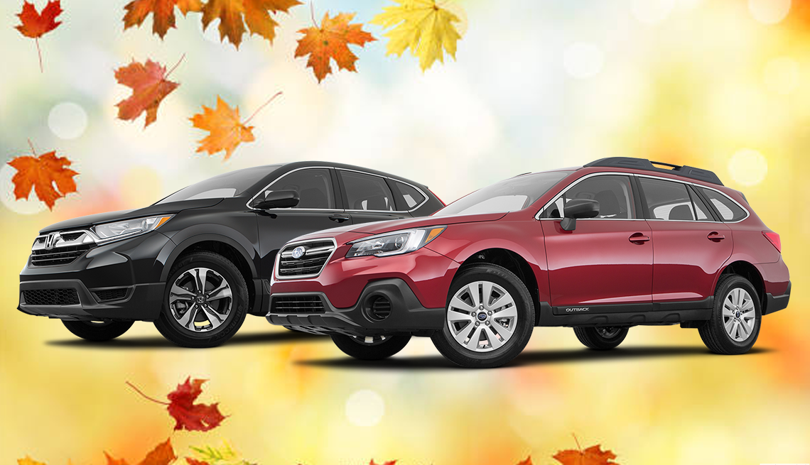 Two Suburu vehicles photoshopped on a fall background with leaves