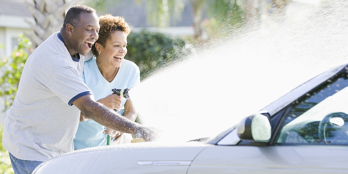 couple washing a car together