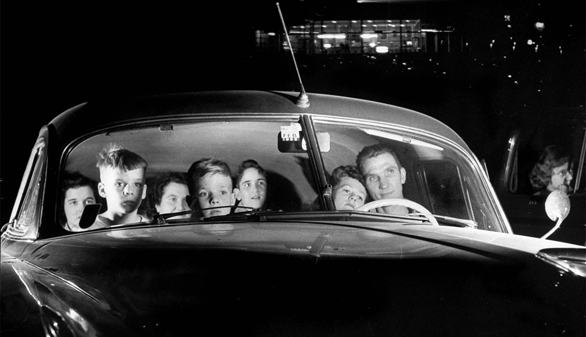 item 4 of Gallery image - Carload of happy movie fans including parents with their kids