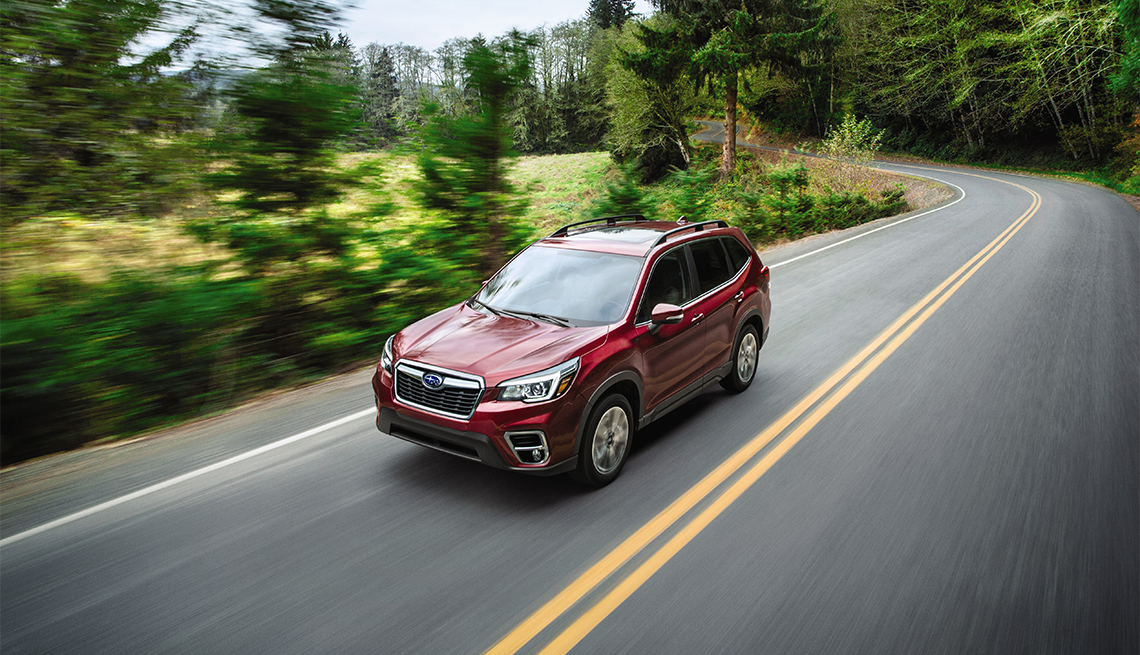 item 7 of Gallery image - red Subaru Forester on a scenic road