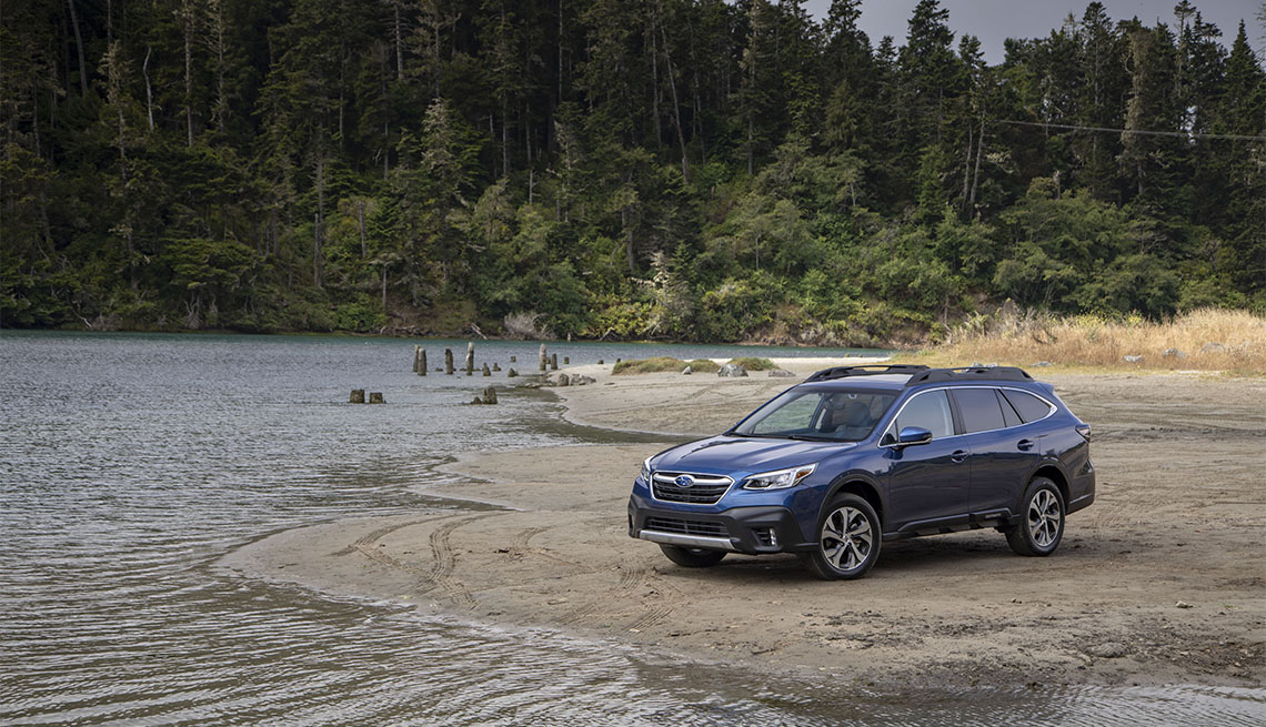 2020 blue Subaru Outback parked near a body of water