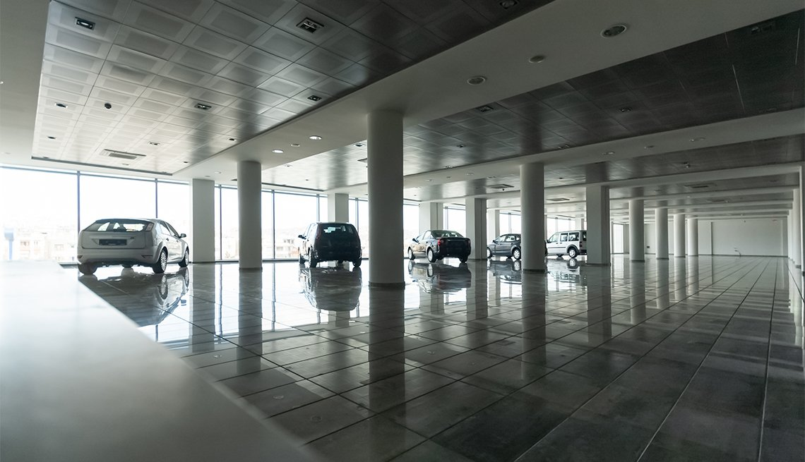 cars parked inside a dealership