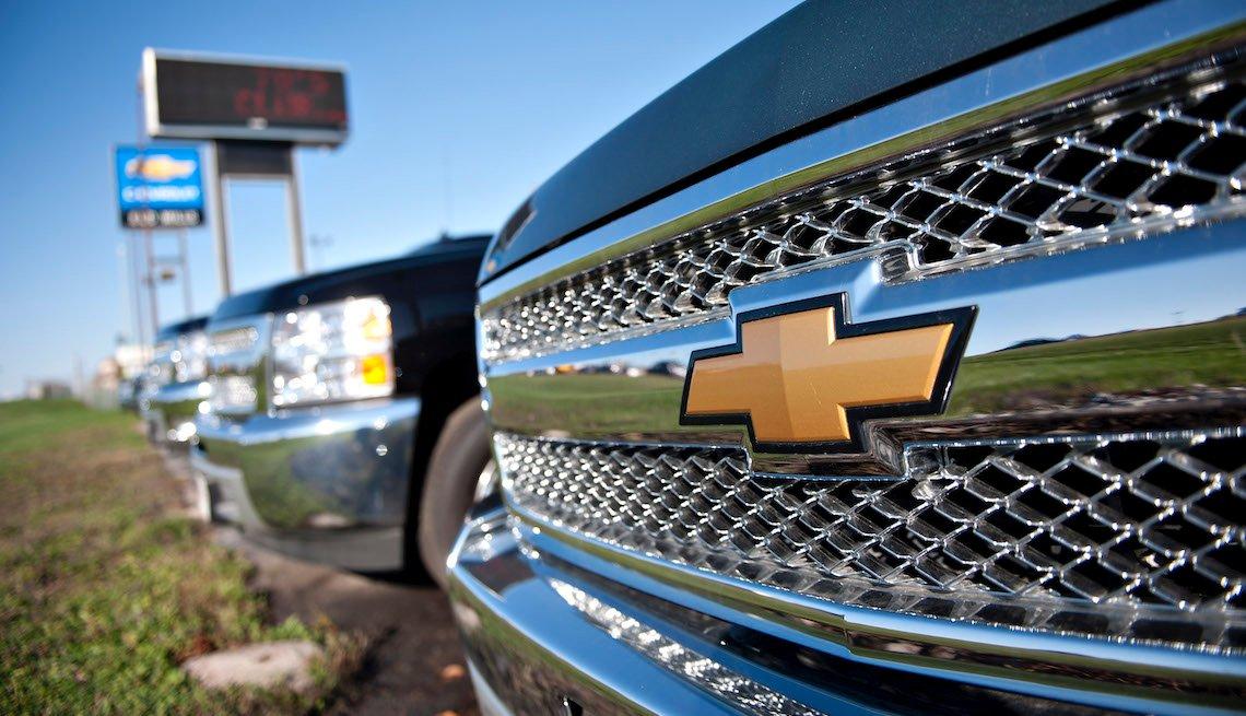 2012 Chevrolet Silverado pickup trucks on a car lot in Moline, Illinois