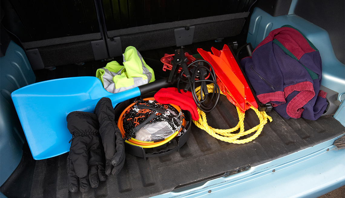 winter emergency equipment in the trunk of a car