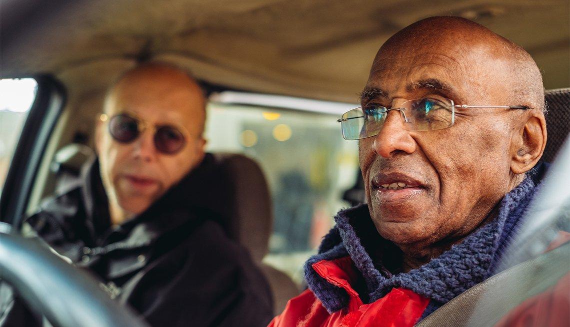 Two men driving in the mini van
