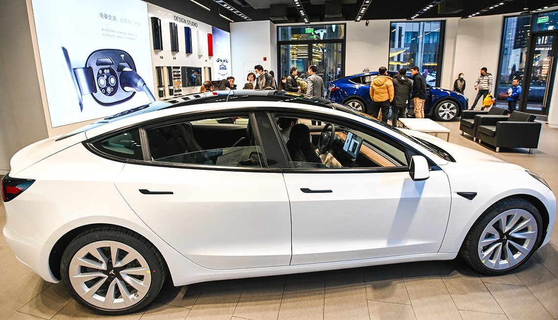 item 9 of Gallery image -  A Model 3 vehicle is seen at a Tesla flagship store on January 4, 2021