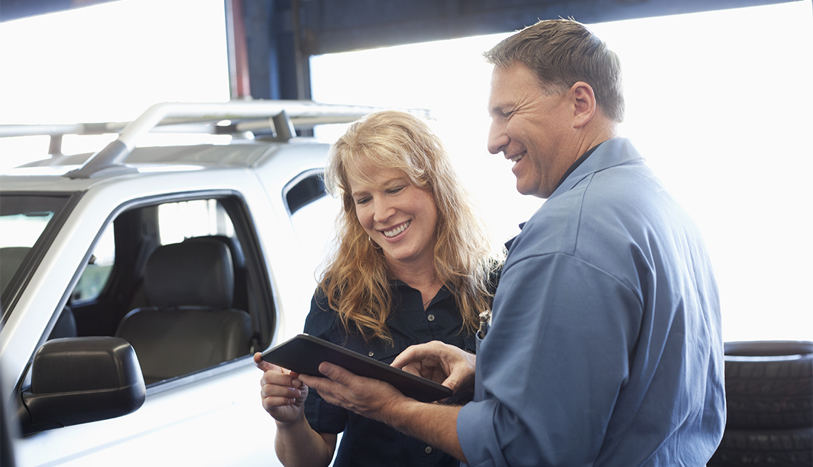 Mechanic shows owner what needs repairs