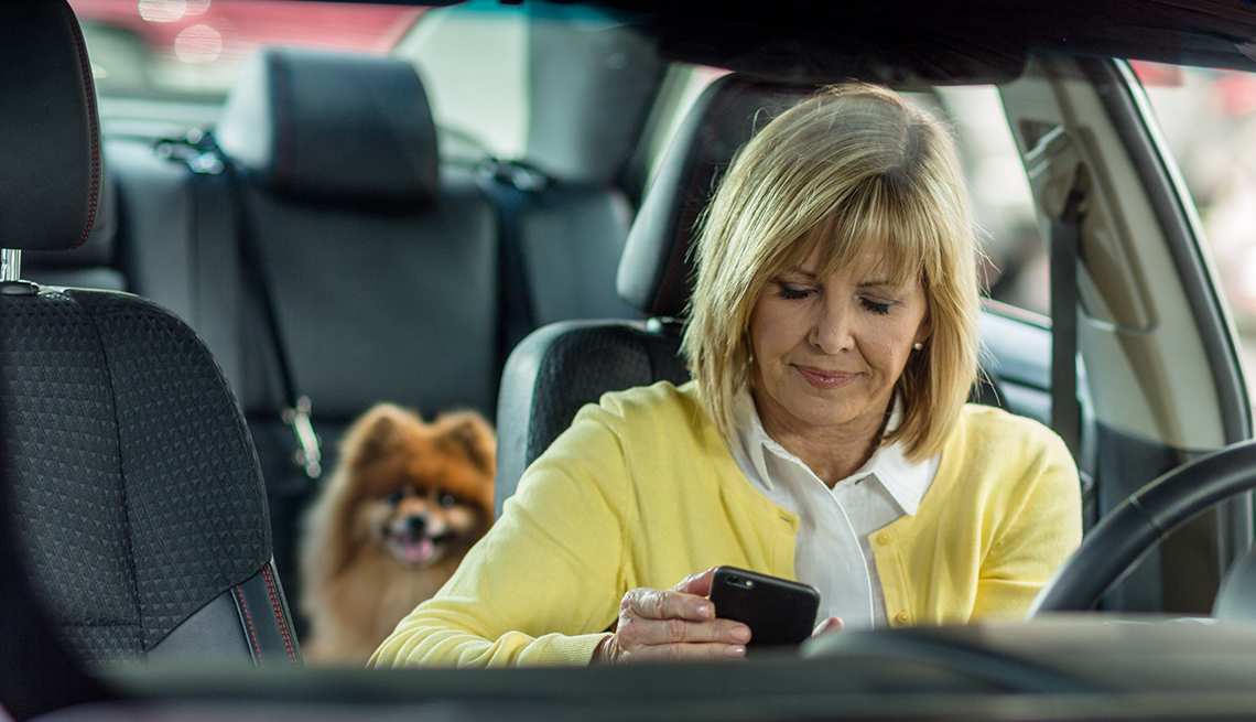 Woman Using Smartphone While Driving Car, Avoid Distractions, AARP Driver Safety