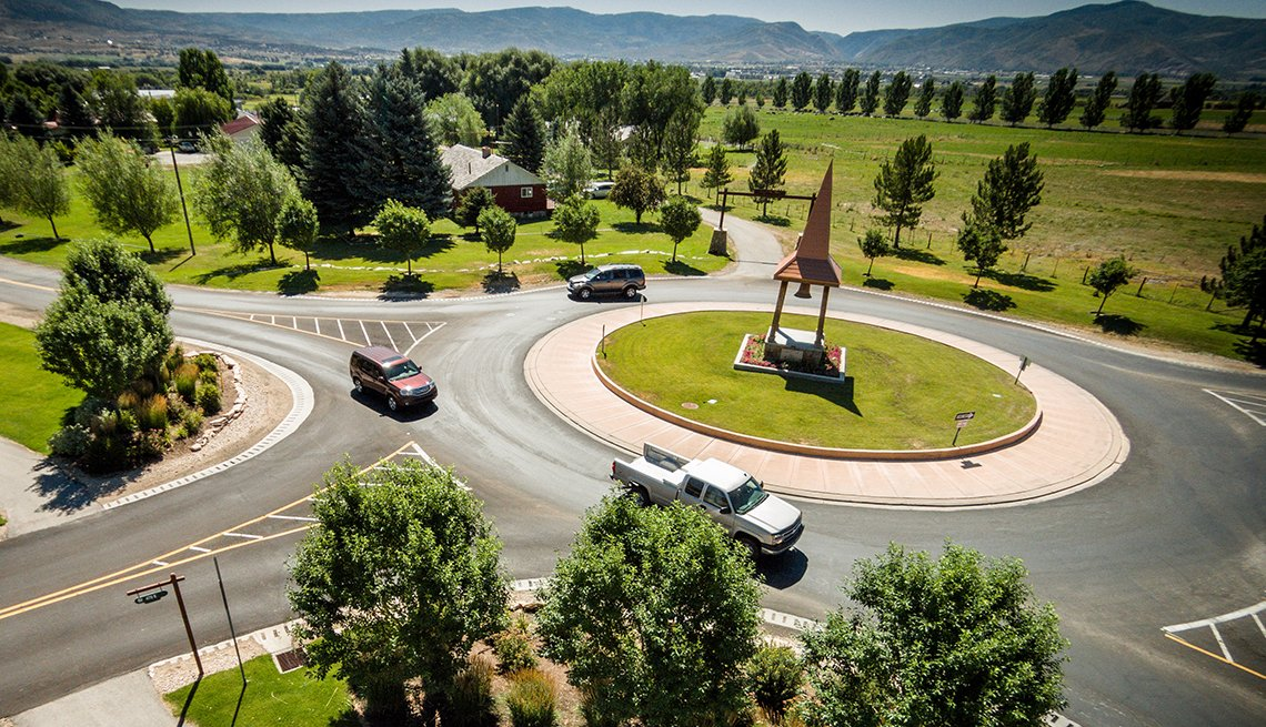 Cars in Roundabout Traffic Circle, Respect Roadway Patterns, AARP Driver Safety