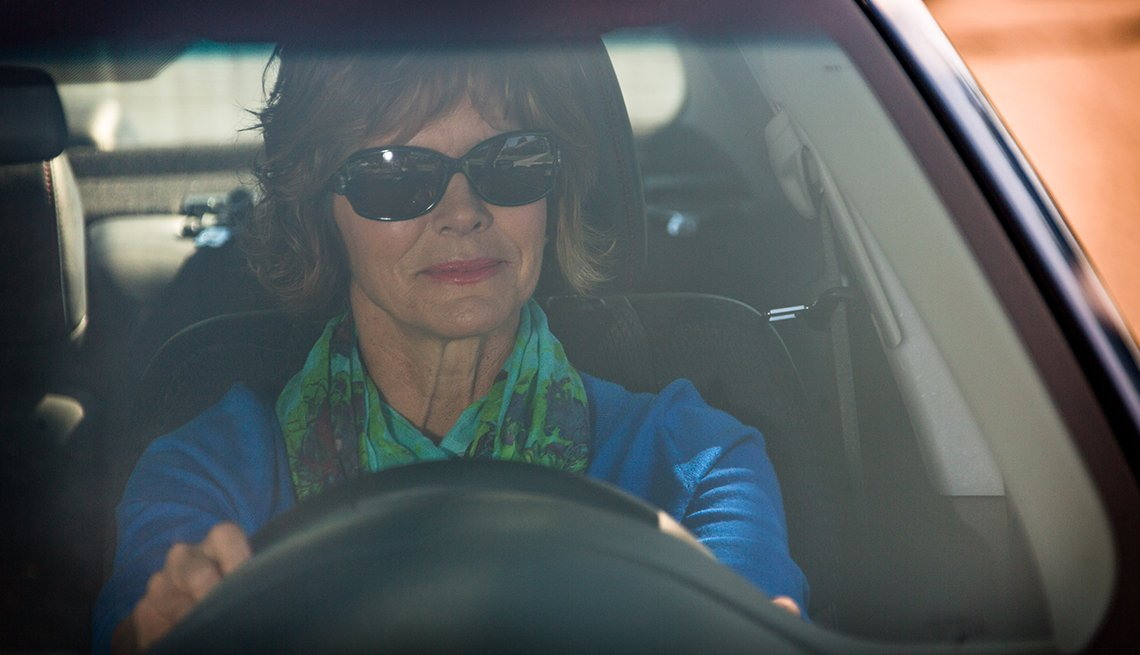 Mature Woman Wearing Sunglasses Driving Car, Stay Sharp, AARP Driver Safety