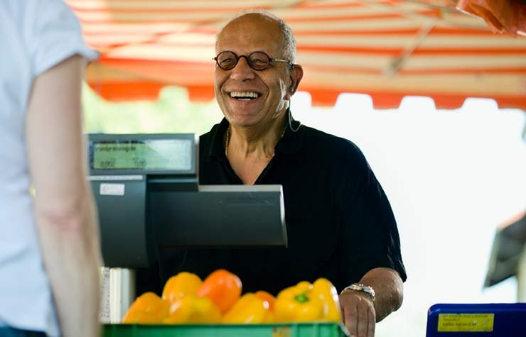 Man Checking Out at an Outdoor Market hartford