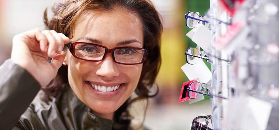 Woman smiling wearing eye-glasses vision insurance member benefit