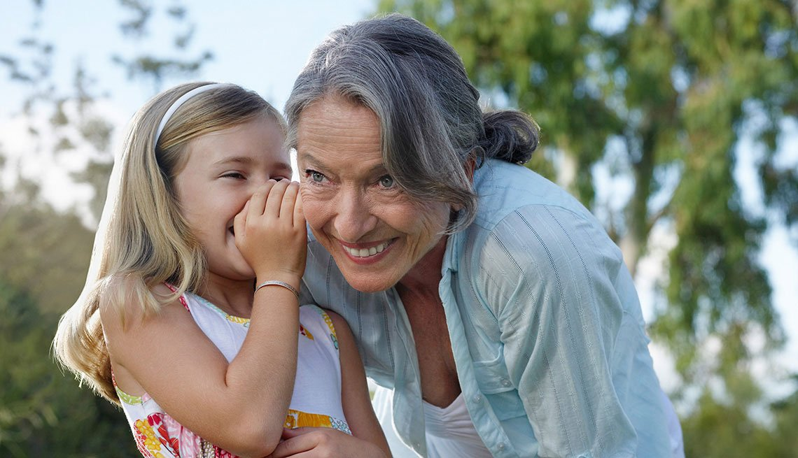 young girl whispering in grandmother's ear, Hearing Program