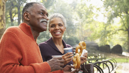 Couple with Coffee and Pretzels in City Park, New York City, New York, USA