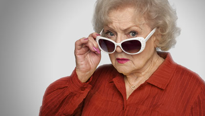 Betty White peers over her sunglasses while promoting AARP membership.