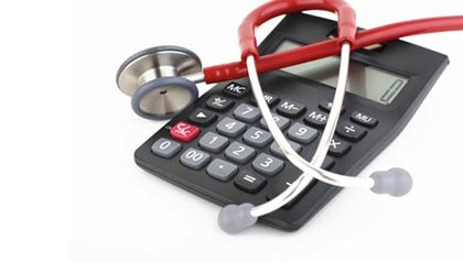Stethoscope and calculator. Healthcare costs calculator (Aslan Alphan/Getty Images)