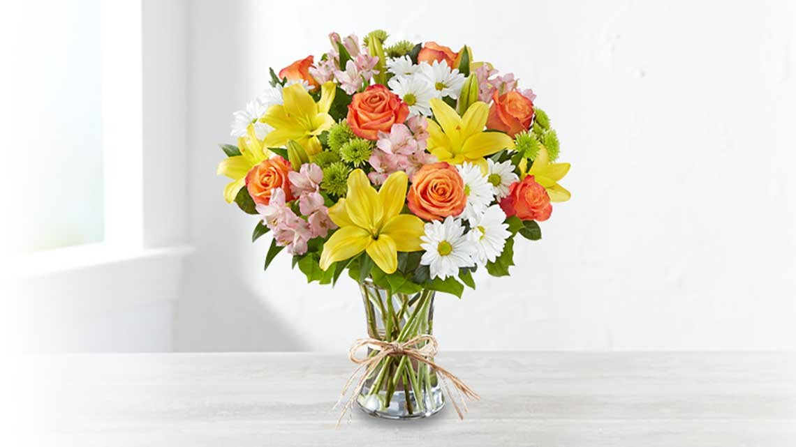 colorful flower bouquet in glass vase