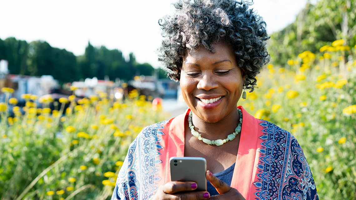 woman holding a phone and smiling