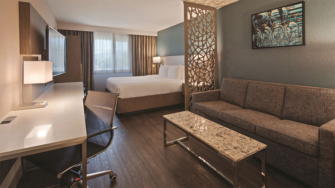 Hotel suite, bed, desk, couch