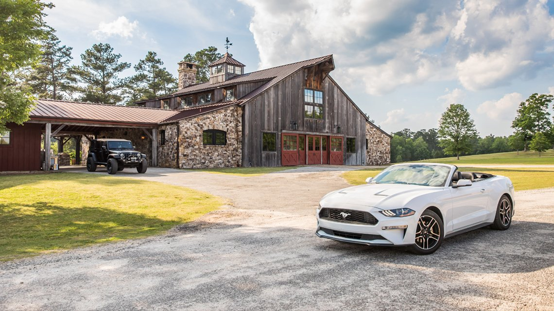 White convertible, rustic house