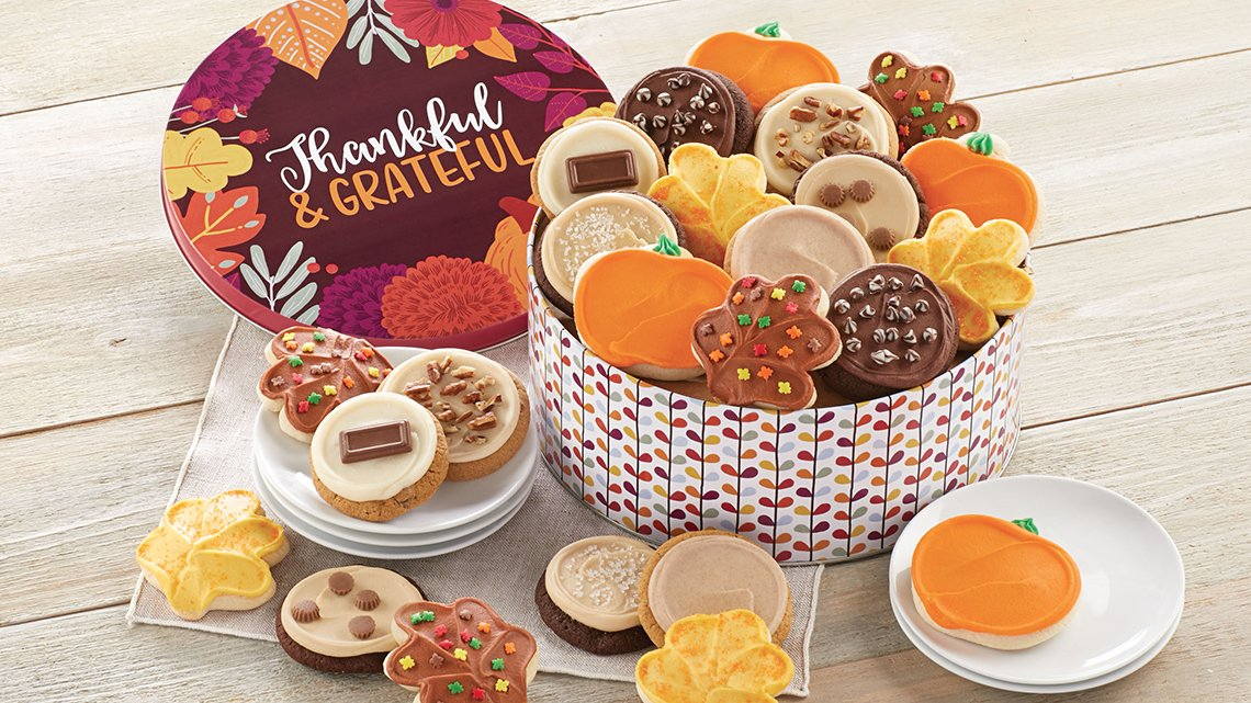 Tin of Halloween cookies with words Thankful & Grateful on top