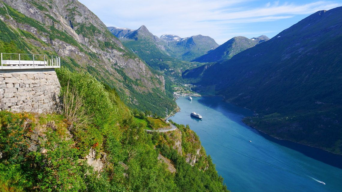 Fjord Geirangerfjord with ferry boat, Norway