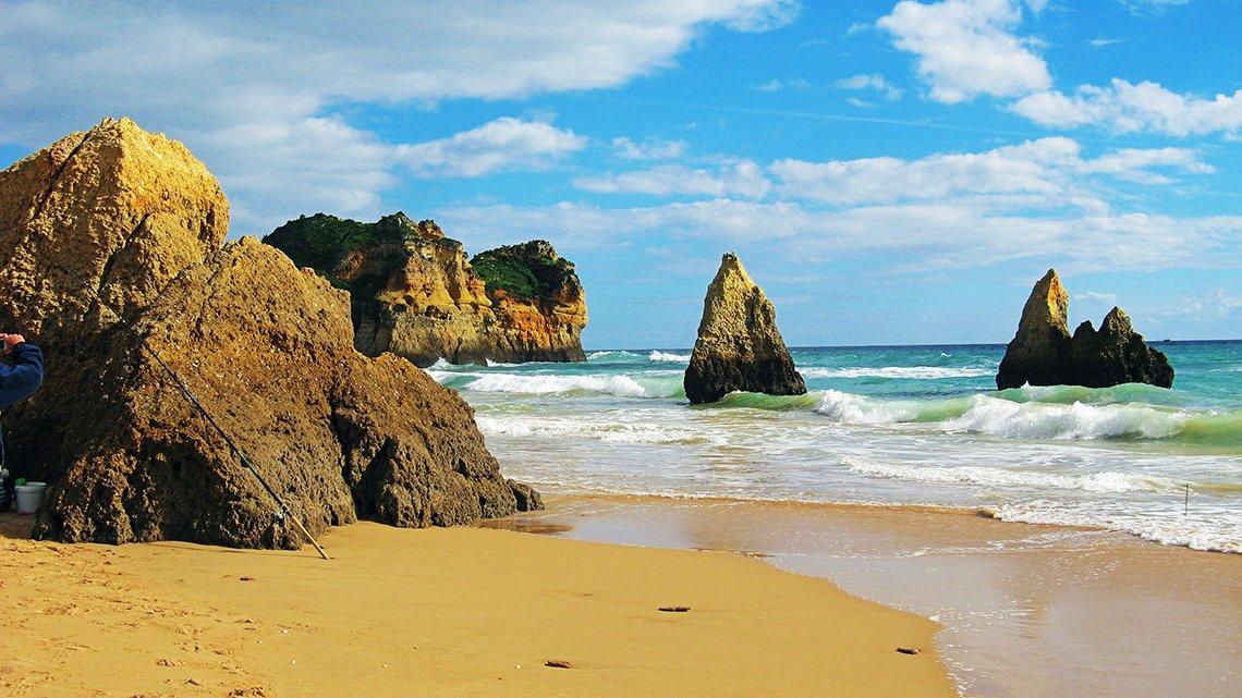 Portugal, large rocks, beach, blue ocean