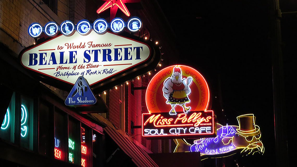 Brightly lit signs on Beale Street at night