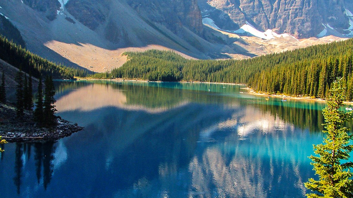 Canadian Rockies, lake, surrounded by forest, mountains