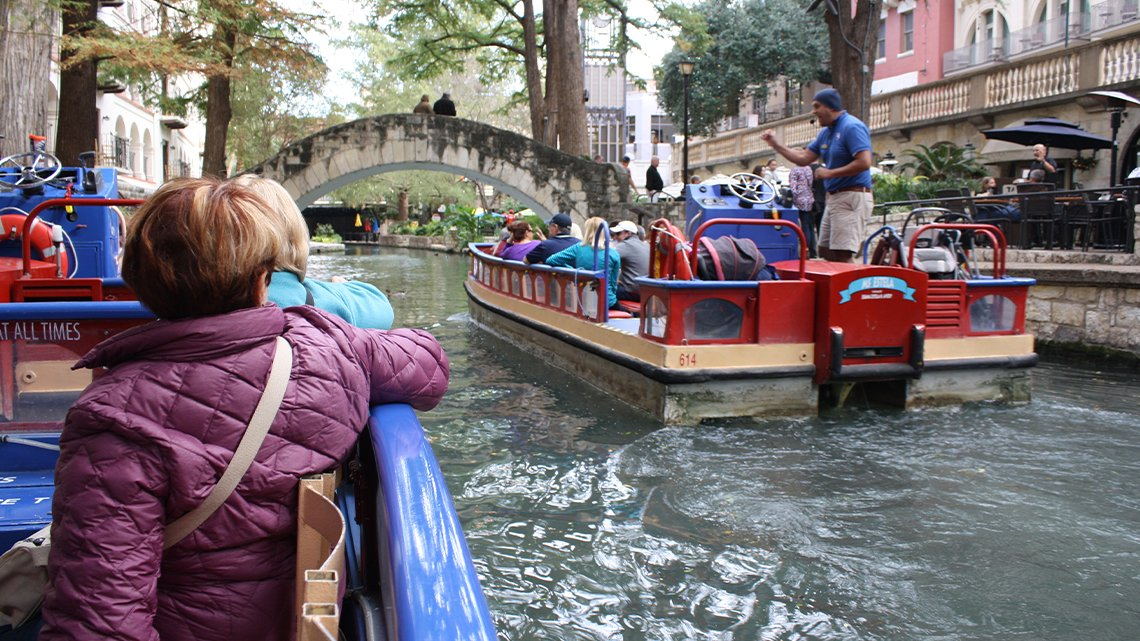 Flatboats filled with people on river