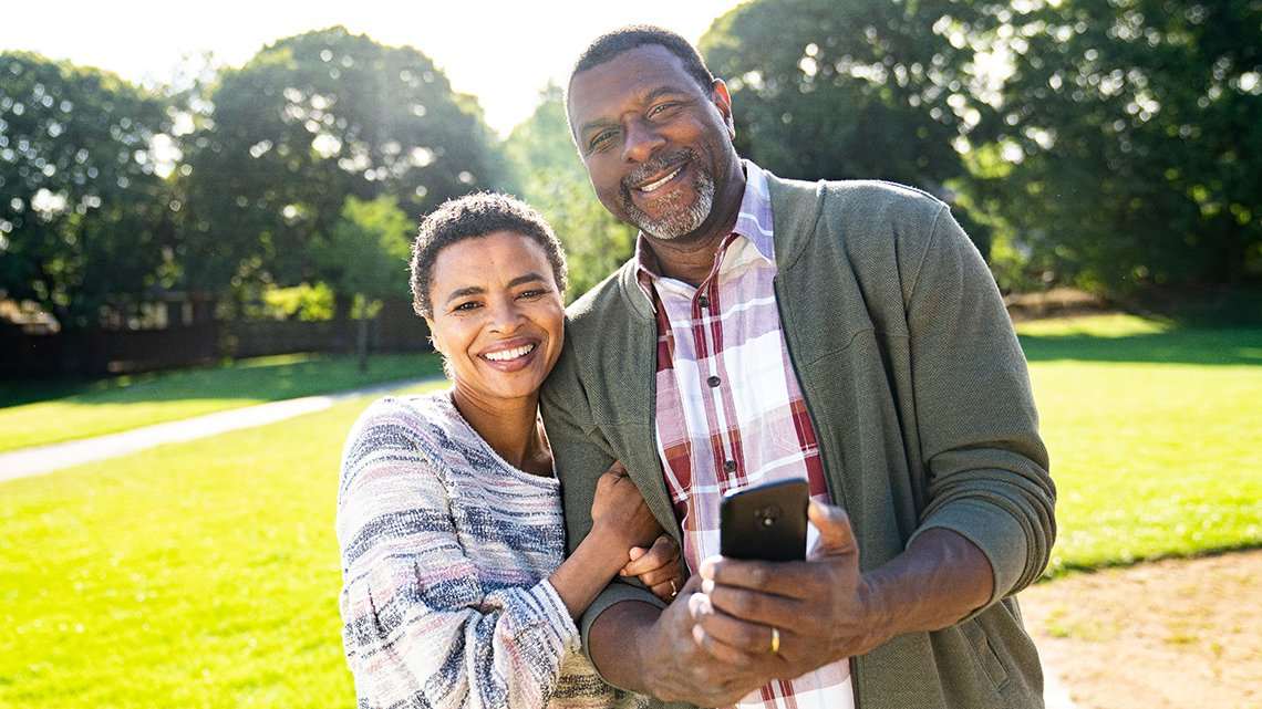 Smiling African American couple outside