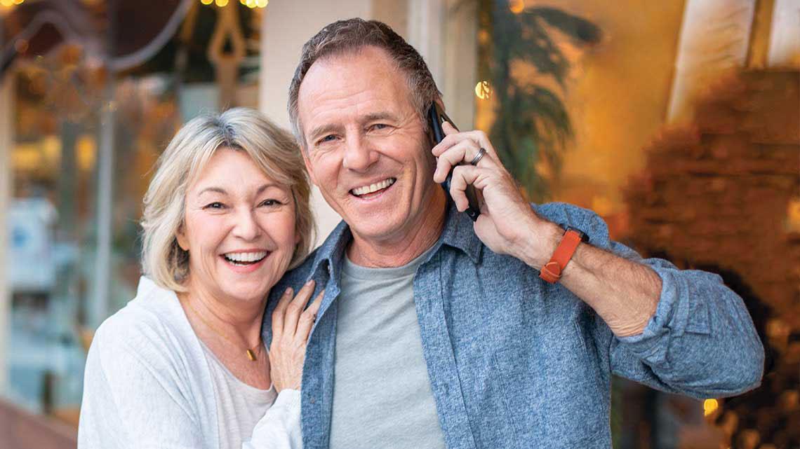 woman hugging man on phone