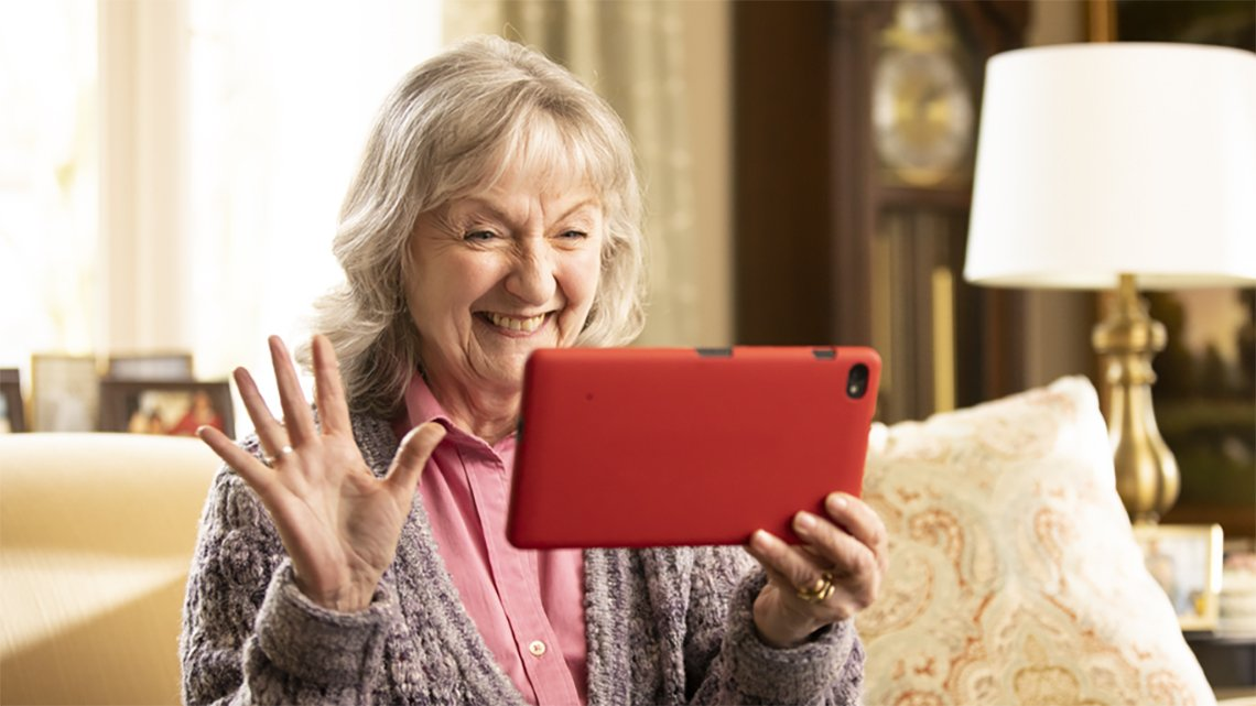 Smiling mature woman with Grandpad tablet