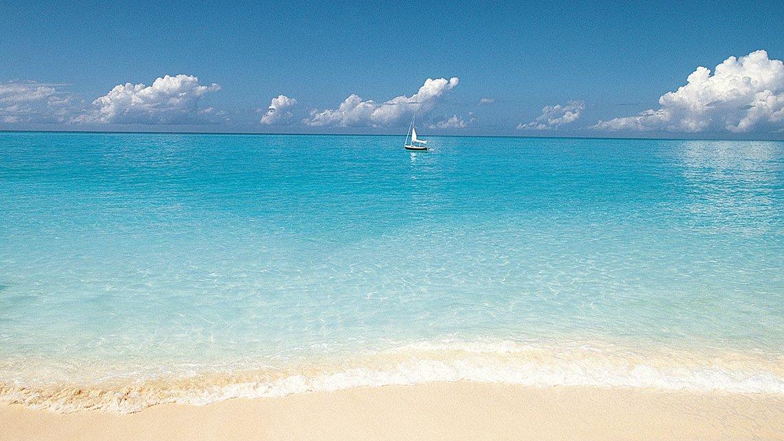 Sailboat on clear blue ocean