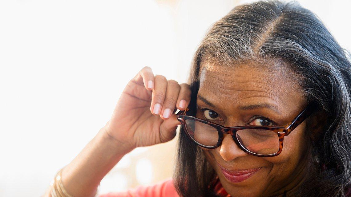 Elder woman peering over glasses
