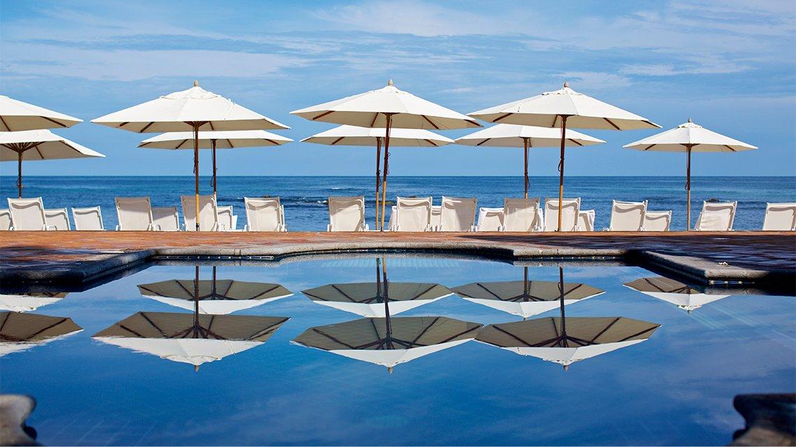 Ship umbrellas around pool