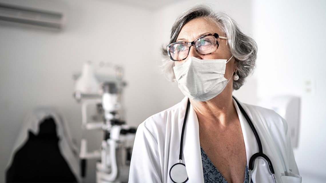 female eye doctor, mask