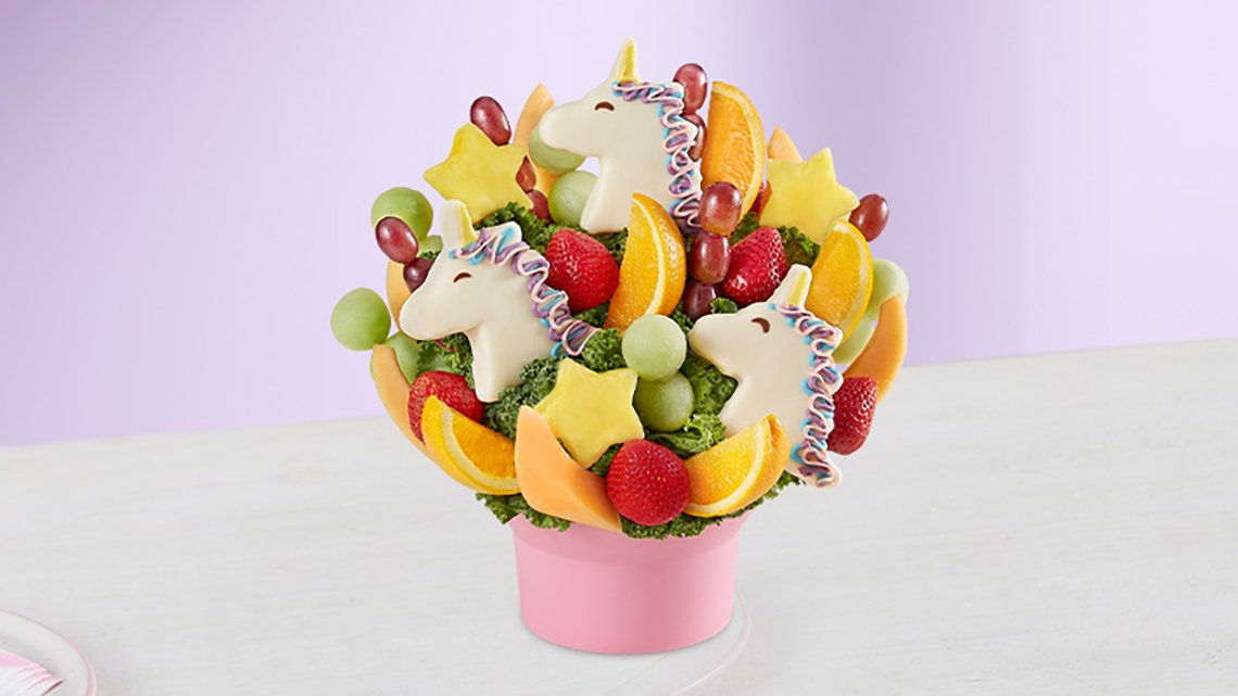 fruit and unicorn decoration in pink basket