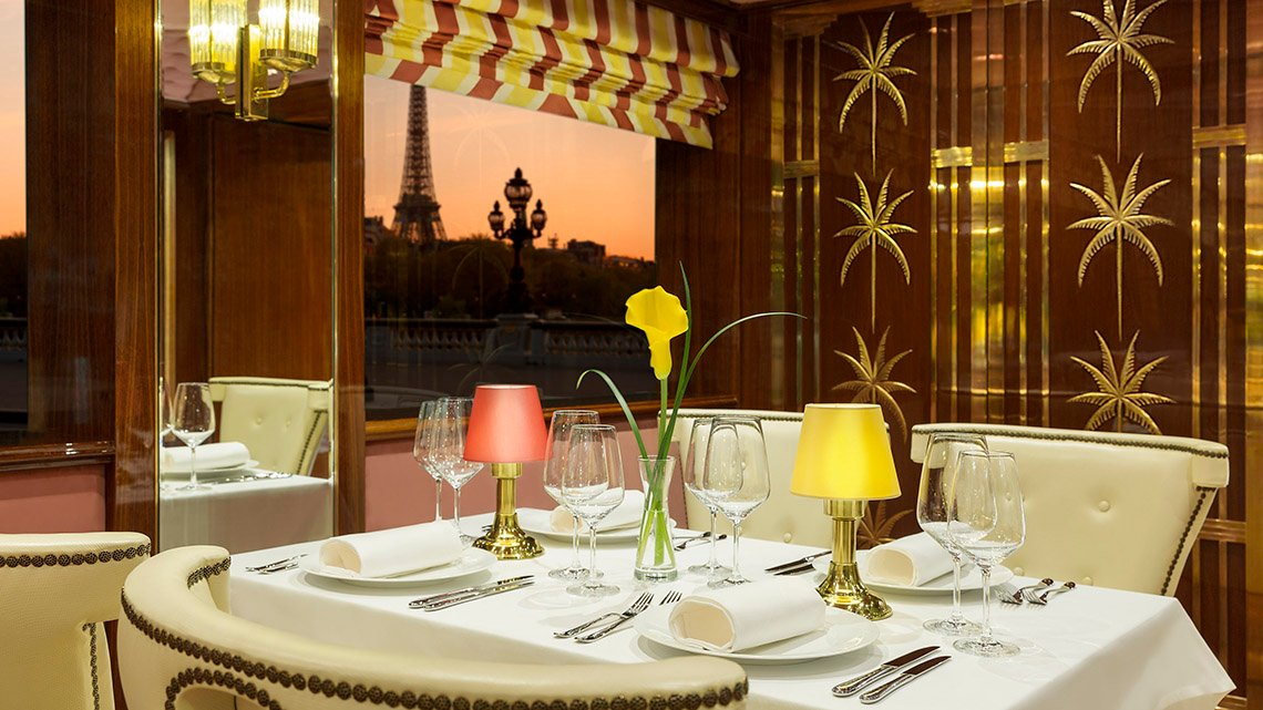 Table set up for meal, Effiel tower through window