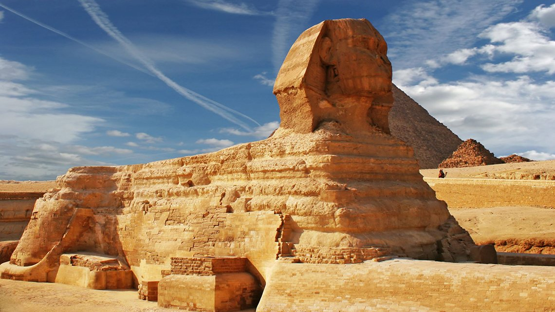 Egypt - Sphinx, daylight, clouds in blue sky
