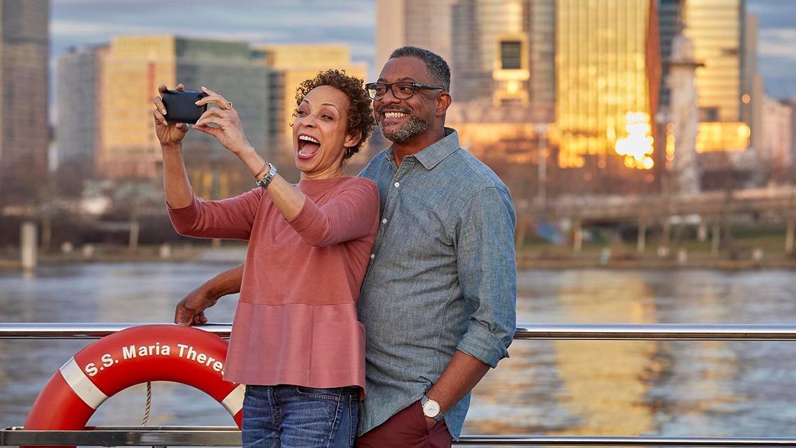 African American couple taking selfie