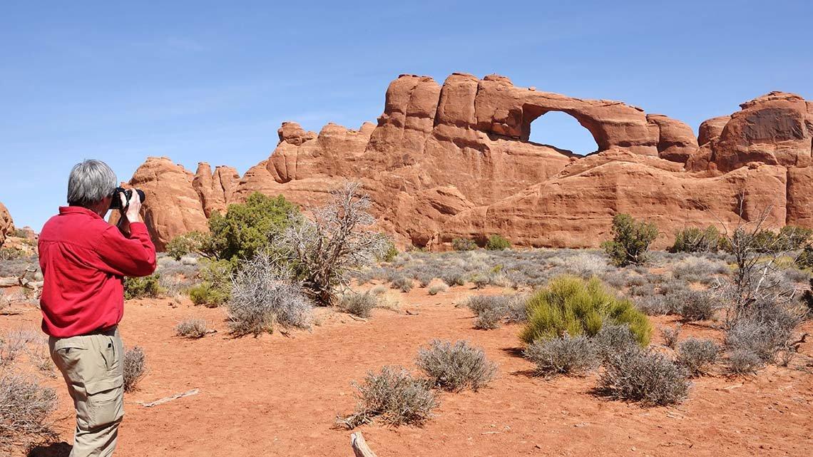 Canyon Lands - Man taking snapshot of rock formation