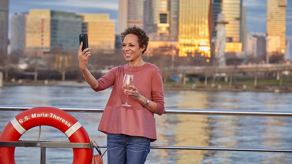 woman taking a selfie on a cruise ship