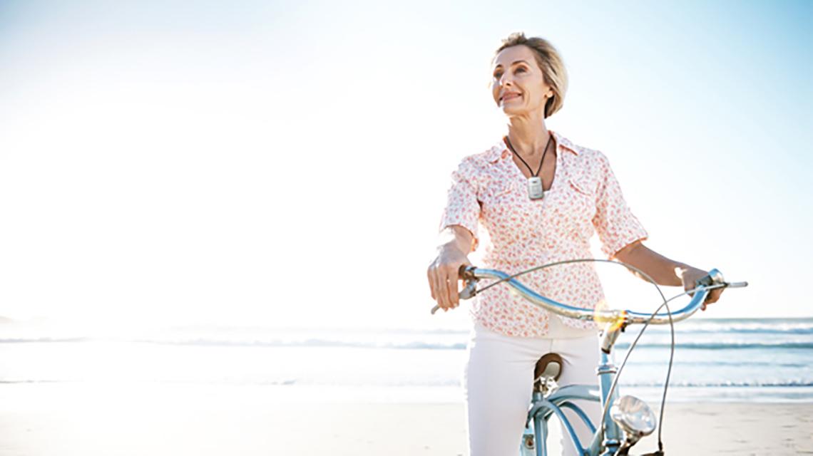 woman biking on the beach
