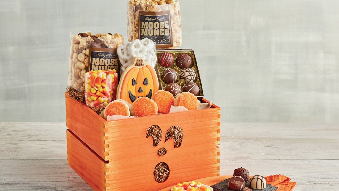 Box filled with Halloween candies, cookies, popcorn