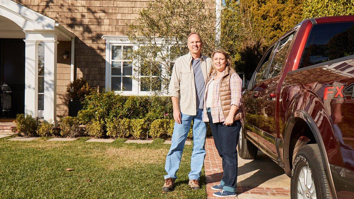 Couple outside, truck, house