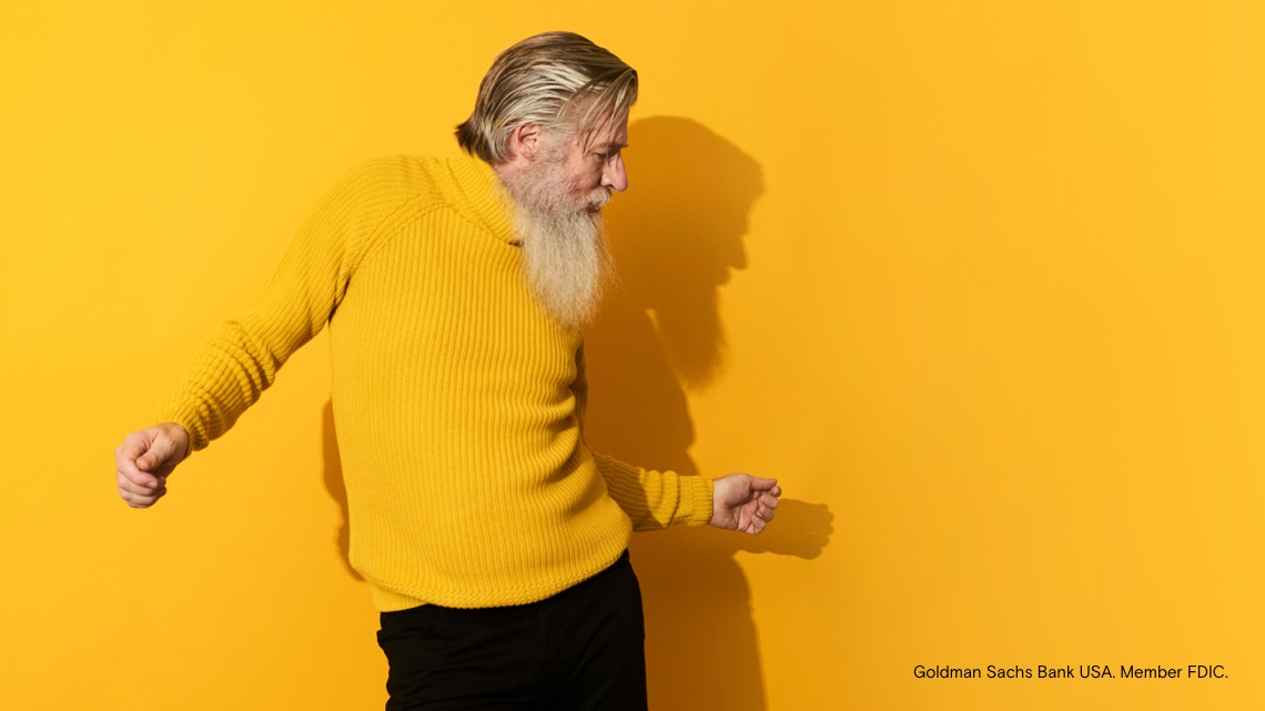 man dancing, yellow sweater, yellow background