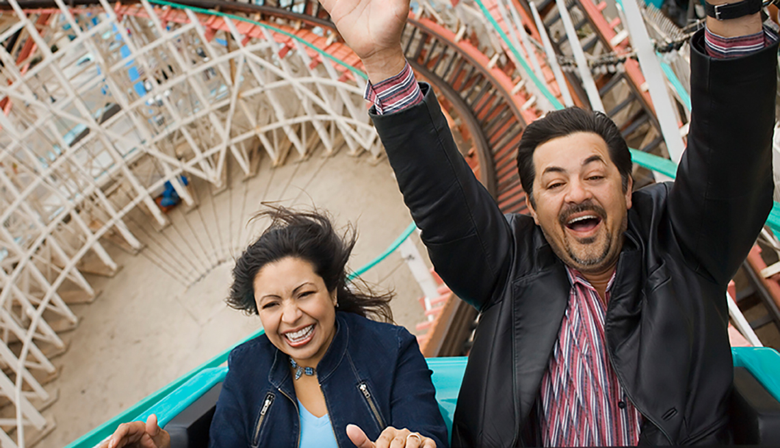 Man woman on roller coaster