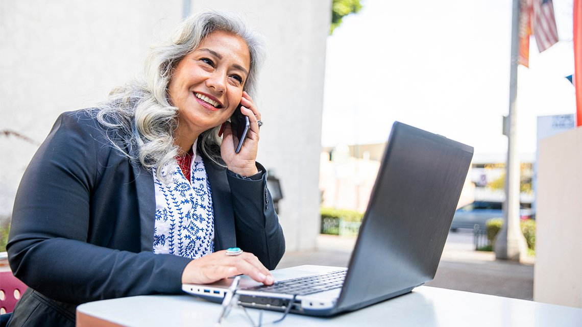 woman cellphone laptop outside