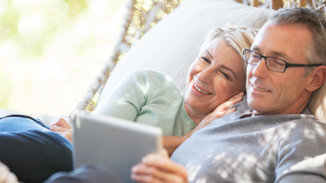 Couple Snuggling with Laptop
